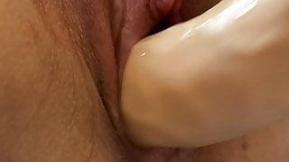 Wife Masturbates juicy pussy with a big Clit