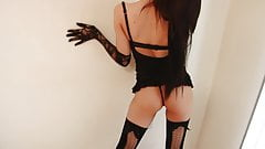 Erotic brunette takes sexy poses in black lingerie