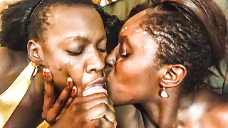 2 african ebony girls feeding on 1 big dick