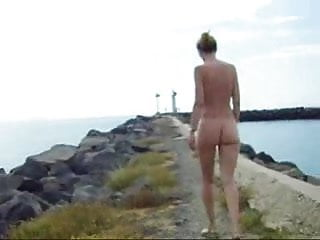 Office gals nude Firm titty gal takes a nude walk by the ocean.