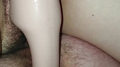 Pegging him with strapless dildo