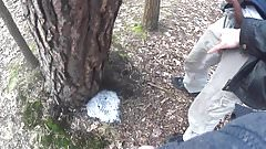 two friends pissing together a big puddle under the tree