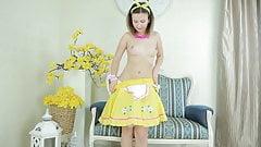 beautiful teen girl gets her yellow dress off