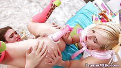 Ass toyed enema les gape filled with cream