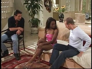 Black chick gang bangs white guys - Two white guys screwing a black chick on the couch