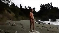 stroking on nude beach, stranger finishes him off