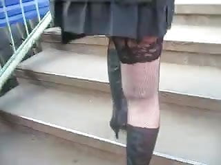 Teens in short dresses - Girl in short dress and fishnet stockings going upstairs