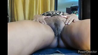 Mature 67yo Latina woman masturbates hairy pussy and dances