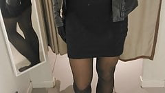 Pantyhose girl in fitting dressroom showing her out fit