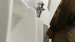 Older man getting relieving his bladder