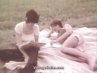 Teen life in the 1960s Young couple relaxing in the nature 1960s vintage