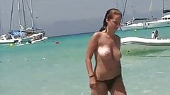 Group of topless friends on the beach, one with huge tits