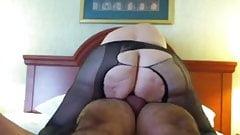 Mature in torn pantyhose
