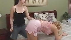 two girls spanking each other