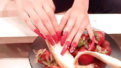 Francoise longe red nails scratching fruit
