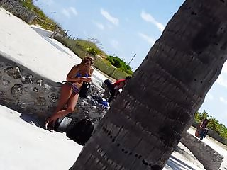 Purple shirt girl leaning nude - Candid voyeur bikini girl leaning on wall