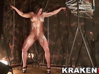Bdsm scene fisting - Muscled milf tied with tweezers in her pussy in a bdsm scene