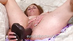 Cristine Ruby fucks herself with a massive black dildo