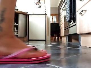 Skirt flipping up tgp - Feet playing with pink flip-flops close-up.
