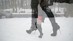 hooker in high heels boots walking in snow + upskirt