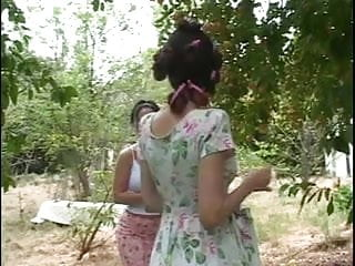 Sex outsides str8up - Mature milf takes younger sluts top off and sucks her tits outside