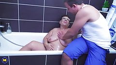 Big granny takes young cock after shower