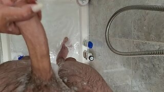 Giving his dick pleasure in the shower