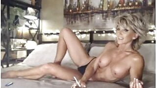 Topless musclewoman in bed