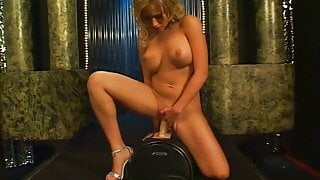 Gorgeous busty beauty rides sex-machine at the strip club