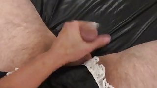 Dominatrix masturbates tied man