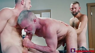 Two gay studs bend over for wild fisting in the office