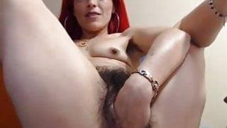 Redhead Tamara fisting on webcam.