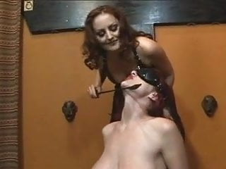 Sexy women in black leather - Cute redhead gets dominated by redhead in black leather