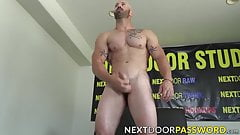 Tattooed and bald stud with beard playing with his cock