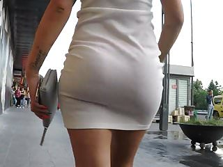 Pissed in her thong - See-through skirt shows her thong for the world to see