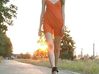 Teen high street fashion Skinny girl in heels on street
