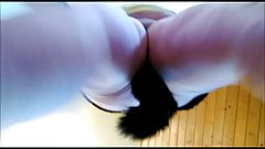 The slave girl shows off her anal tail