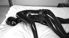 Latex with handcuffs and anklecuffs restrains and magic wand