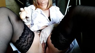 Nurse fucks herself with a dildo in the workplace