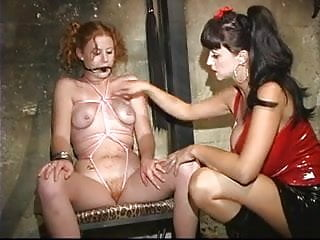 Lesbian teen girl strap-on Curly redhead girl strapped tightly with a pink rope and has a gag ball