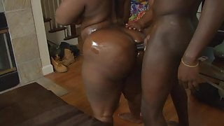 Two horny sluts get on their knees and deep throat a hard cock