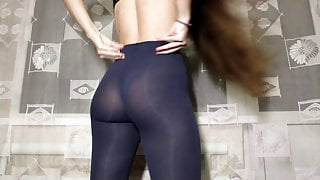Fitness girl shows her ass in leggings. Inserts fingers