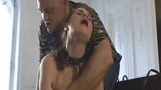 A slave girl learns to serve sexual needs of S&M club owner