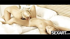 Blondes press their big tits together as they finger-fuck