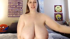 lady with huge tits sucks and titty fucks a dildo