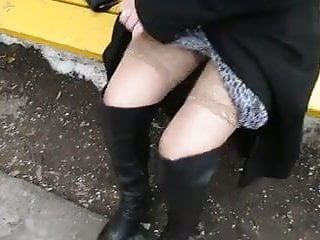 Black leather upskirt Girl in black leather boots and stockings outdoor 1