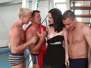 Mary the three breast hooker Brunette keeps all the three cocks engage throughout the foursome session