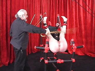 Leather masked blowjob Spread-eagled shackled woman in leather mask and hood gets caned on her ass