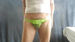 Sissy bitch models his green nylon bikini.
