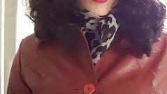 Female masking in leather coat